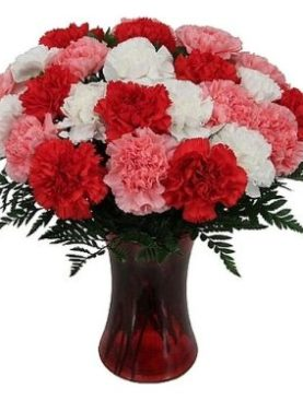 Lovely Carnations in a vase with a helium balloon